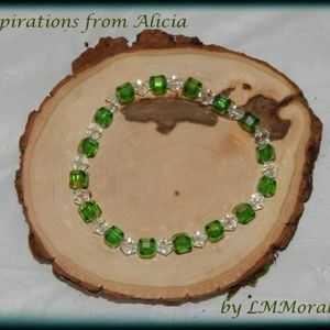 Green crystal and clear bead stretch bracelet.